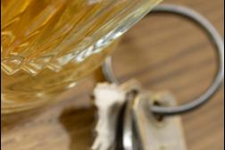 Car keys next to a drink